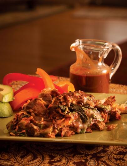 mexican enchilada with enchilada sauce