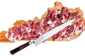 ham on cutting board with knife
