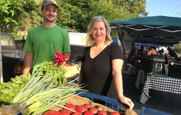 Sherry Hurley, chef and owner of Farm to Fork Catering and Cafe, sources locally at the Bardstown Road Farmers' Market from vendors like farmer Parker Silliman of Parker's Patch