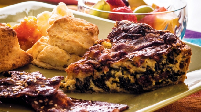 springtime quiche with peppery arugula paired with glazed bacon recipe and fresh fruit